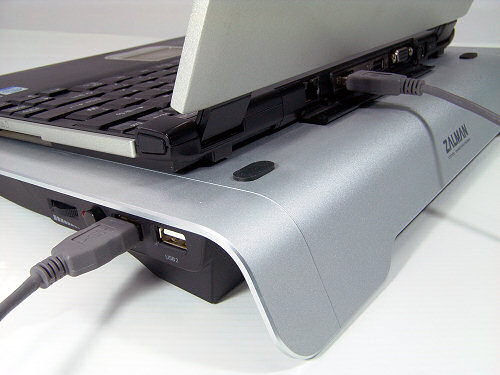 Rear corner view of Zalman ZM-NC1000 showing laptop in place